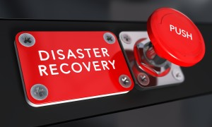 Close up on a red panic button with the text Distaster Recovery with blur effect. Concept image for illustration of DRP business continuity and crisis communication.